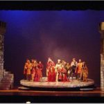 """""""Camelot"""" on stage."""